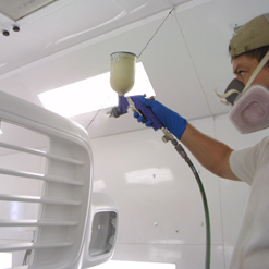 Nitrile gloves in an automotive paint spraying booth
